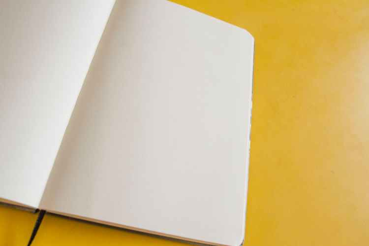 white book page on yellow surface